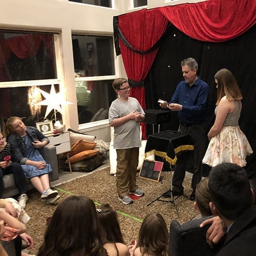 Teens enjoy Denver kids magician Chad Wonder's magic show
